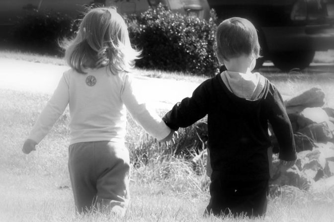 little-boy-and-girl-holding-hands-in-black-and-white_4