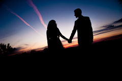 silhouette-young-couple-love-bride-groom-posing-field-beautiful-sky-sunset-background-their-wedding-day-45083964